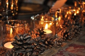 candle and pinecones